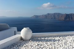 White ceramic pottery on the terrace in Oia town on Santorini Royalty Free Stock Photos
