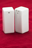 White ceramic salt and pepper shakers royalty free stock images
