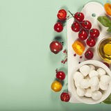 White ceramic serving board and salad ingredients over light blu Royalty Free Stock Image