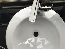 White Ceramic Sink With Stainless Steel Faucet Stock Images