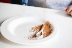 White Ceramic Spoon On A White Plate Stock Photo