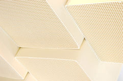 White Ceramic Substrate. Square ceramic catalysts used in the manufacturing of emission control products to reduce pollution from large industrial engines and Royalty Free Stock Image