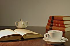White Ceramic Teacup on Brown Wooden Table Beside Book Stock Image