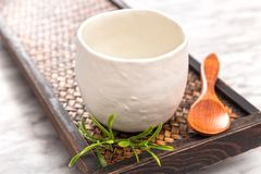Ceramic teacup on a wooden tray royalty free stock image