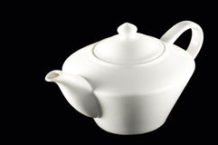 White ceramic teapot pitcher. Picture of a white ceramic pitcher on black background Royalty Free Stock Photo