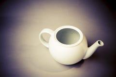 White ceramic teapot. Retro style Royalty Free Stock Photo