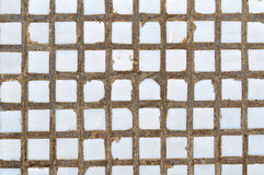 White ceramic tile on the concrete wall - textured background - Stock Images