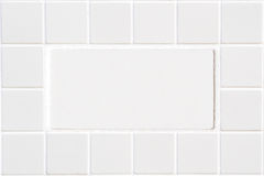 White ceramic tile with squares in rectangular form Stock Image