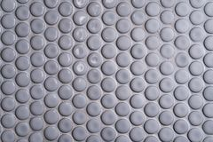 White ceramic tile wall with many small round unique pattern. Top view of bathroom wall tile is a round button tile. Circle white Stock Image