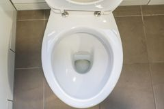 White ceramic toilet bowl for people health. Close up white ceramic toilet bowl Royalty Free Stock Photography