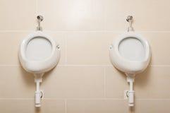 White ceramic urinals in for men in public toilet Stock Photos