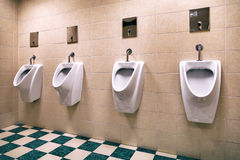 White ceramic urinals tile Royalty Free Stock Photography