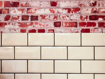 White Ceramic Wall Tile Beside Red Concrete Bricks Stock Images