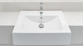White ceramic wash basin with a automatic tap and drain Stock Photos
