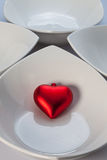 White ceramics bowls and red heart Royalty Free Stock Photography