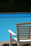 White chair. By thr pool Royalty Free Stock Photography