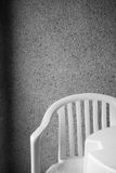 White chair. On a background of an invoice wall Royalty Free Stock Photo