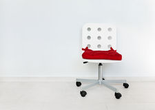 White chair against wall Stock Photography
