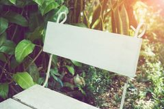 White chair backrest placed in the garden. Used for advertising Stock Image
