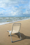 White chair on the beach. Stock Image
