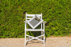 White chair with a blank space for writing. Old white chair with a blank space for writing and  glasses Royalty Free Stock Images