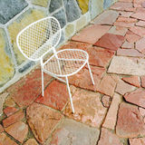 White chair on bright tile background Royalty Free Stock Photography