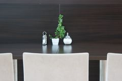 White chair brown modern table. With sugar and plant Stock Photo