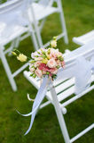 White chair with a bunch of flowers Royalty Free Stock Images