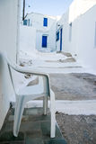 White chair at a classic Greek island street. At Serifos island, Greece Stock Images