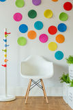 White chair and color spots Royalty Free Stock Image
