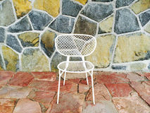 White chair on colorful tile background Royalty Free Stock Photography