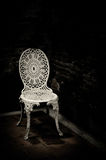 White chair on dark background Royalty Free Stock Photo