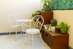 White chair and desk and plant decorating on wooden desk drawer Stock Images
