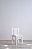 White chair in an empty room Royalty Free Stock Image