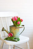 White chair with flowers stock photo