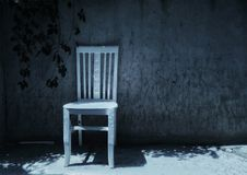 White chair before garden wall Royalty Free Stock Photos