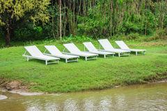 White chair and green grass in vang vieng, laos. Stock Images