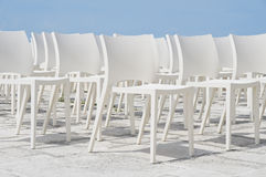 White chair group on blue sky. Stock Image