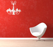 White chair and lamp on red. Interior design scene with a modern white armchair and retro lamp on vibrant red wall Royalty Free Stock Photo