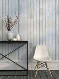 White chair and metal table against the wall of white boards. Modern white chair beside the metal table against the wall of white boards Royalty Free Stock Photography