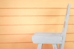 White chair with orange wall background Stock Photography