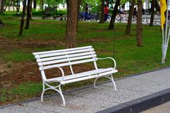 White chair in the park. A white chair in the park Stock Images