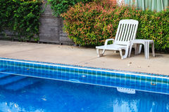 White chair on the poolside Royalty Free Stock Photos