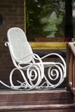 White chair on a porch. White chair staying on a porch Royalty Free Stock Photo