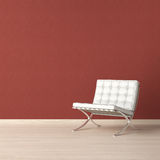 White chair on red wall Stock Photos