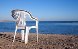 White chair at sand beach Stock Image