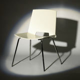 White chair in spotlight Stock Image