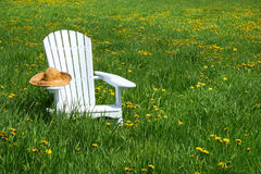White chair with straw hat Stock Images