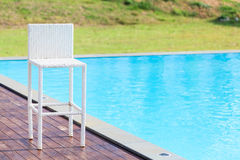 White chair beside the swimming pool Stock Photo
