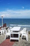 White chair and table on beach Stock Image